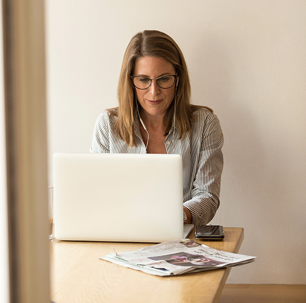 Business woman using her laptop to connect via Zoom for an online session